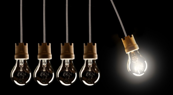 Light bulbs in row with single one in motion and shinning, isolated on ...
