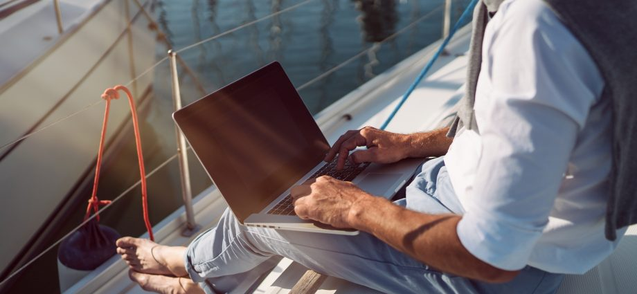 Man on boat researching how to qualify for life insurance