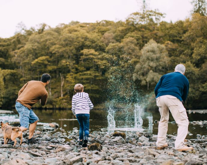 Long Term Life Insurance blog image of grandfather, son and grandson skipping rocks